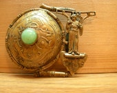 Late Meiji Era Bronze Belt Buckle Figural Geisha Girl with Peking Glass Center Highly Detailed for it 39 s size Antique 19th Century