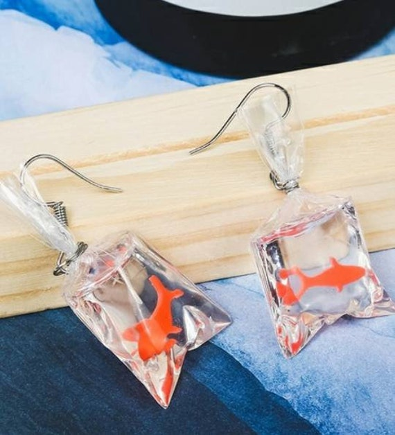 Fake resin fish in baggie surgical steel earrings Made in China!