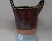 Tall double-handled vessel