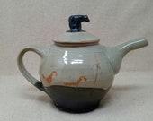 Teapot with sculptural bear ornament
