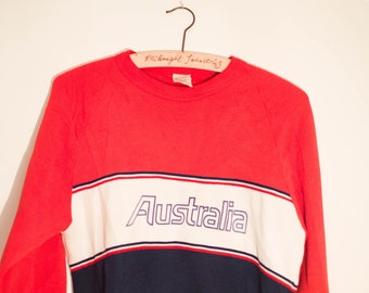 Cool Fun Vintage Slogan Red and Black Sweatshirt with 'Australia' emblazoned on the chest