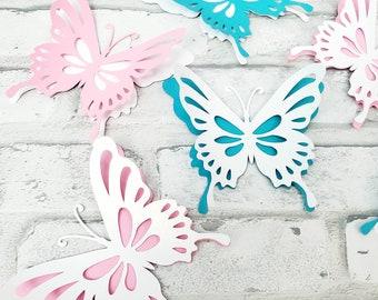 Nine pink, teal and white butterflies nursery wall decor. Nursery butterflies for wall decor. Girl's room butterflies pink, blue and white.