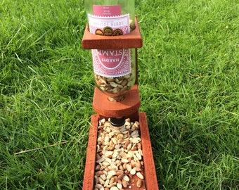 Self replenishing bird feeder