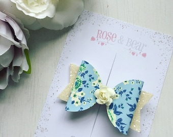 Blue floral hair bow with centre piece