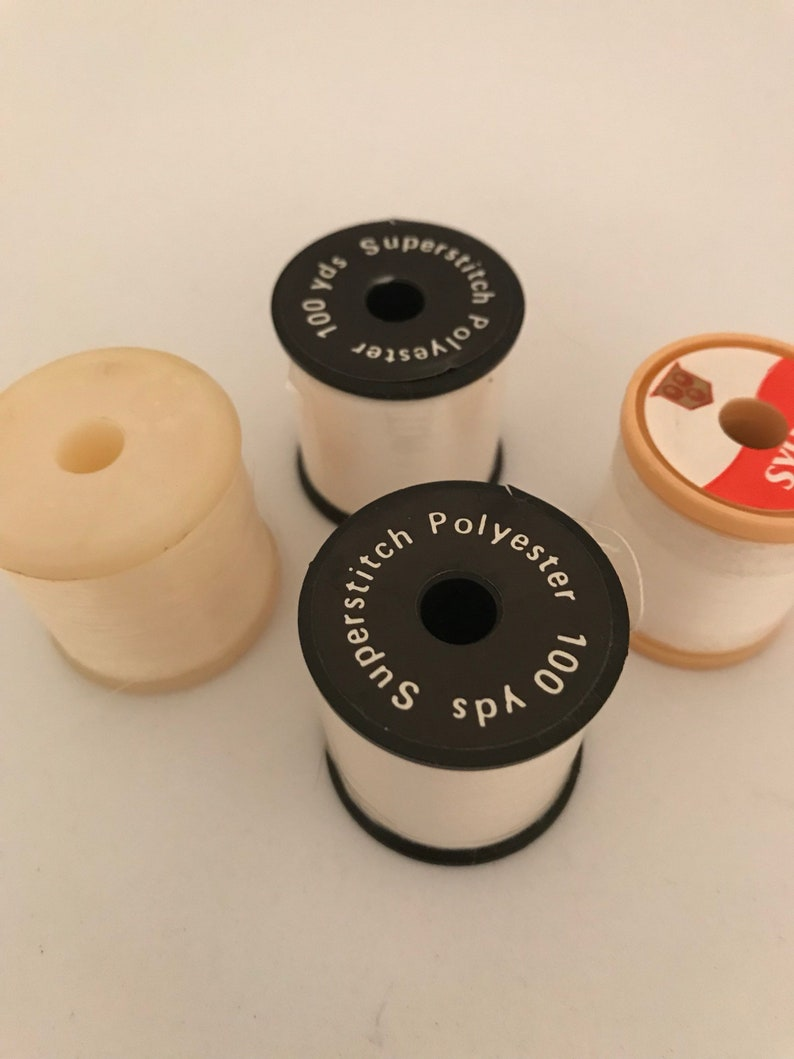 Vintage white and transparent threads four spools of thread