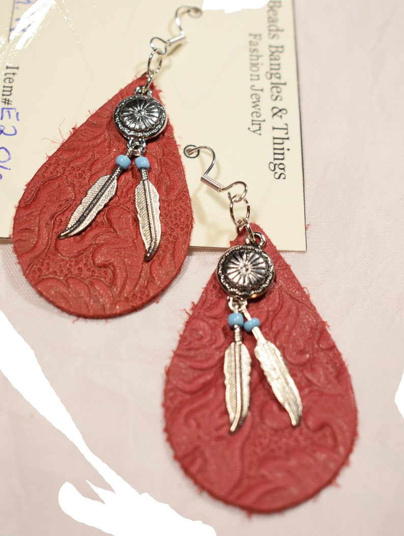 Women\u2019s Red Leather Teardrop earring on sterling silver hooks with silver feather charms