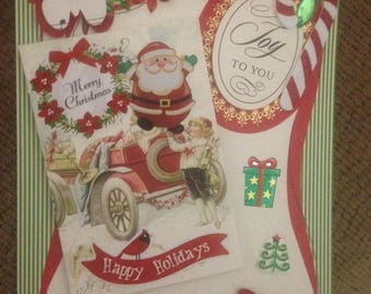 Christmas Card/Handmade/3D/Santa is Riding in on a Car! And he is Surrounded by Lots of Festive Red, White & Green Embellishments