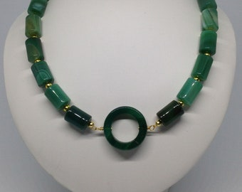 A beautiful understated necklace in green agate tubes with a feature agate donut and gold plated components