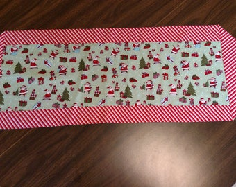Santa and the Christmas Presents on Candy Cane Stripes Reversible Table Runner