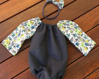 Size 000 Floral/grey playsuit with long sleeves and matching soft headband.