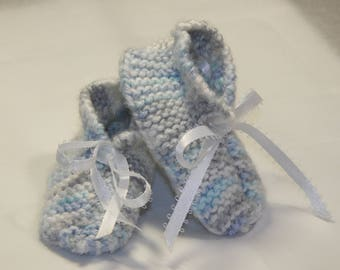 blue and gray handmade knitted baby booties