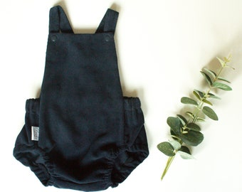626f2281081e Navy needlecord baby romper with cross over straps