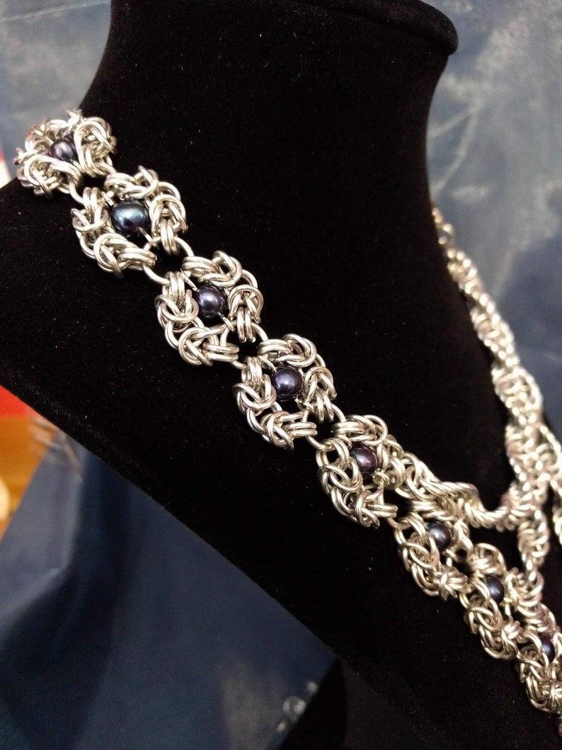 Handcrafted asymmetrical chainmail statement necklace with image 0