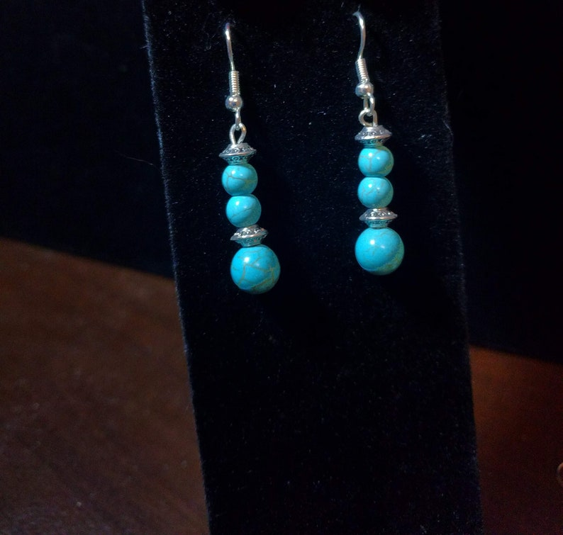 Turquoise  and antiqued silver pewter beaded dangle earrings. image 0