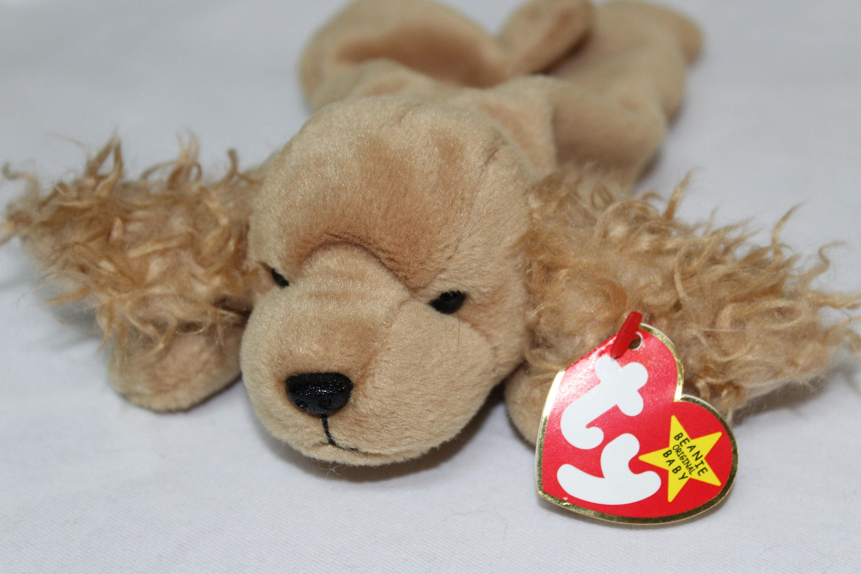 f7c76a454cf Spunky Ty Beanie Baby Value - Parchment N Lead