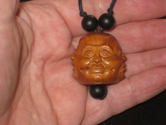 Hand carved 4 sided rosewood pendant with 4 faces.