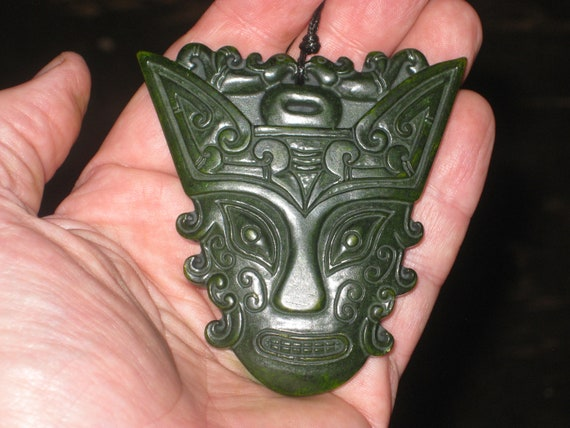 All natural hand carved grade A Jade royal warrior mask pendant, with adjustable necklace.