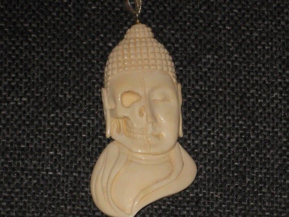 Buffalo bone Buddha face pendant with sterling silver bale.