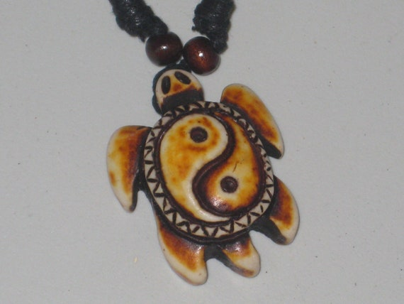 "Surfers Ying Yang turtle necklace, adjustable up to 32"" long."