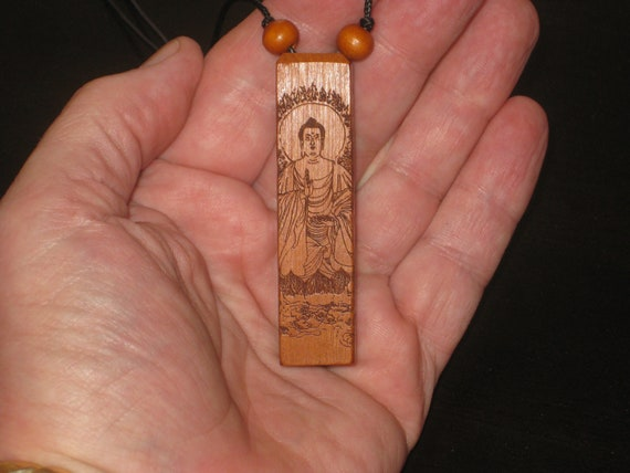 Hand carved rosewood pendant with wood beads.