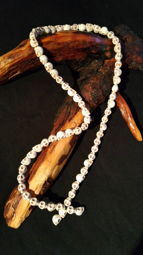 "Howlite skull necklace, 26"" long."