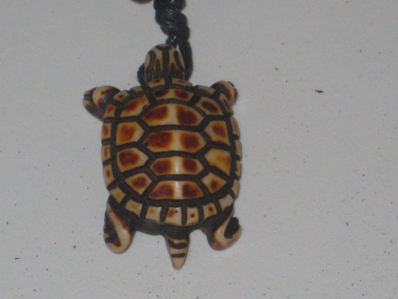 "Surfers turtle necklace, adjustable up to 32"" long."