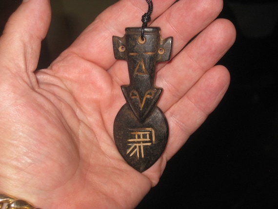 All natural hand carved two sided very old black Jade stone arrow head pendant.