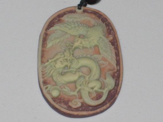 All natural hand carved Jade stone dragon pendant, with adjustable necklace.