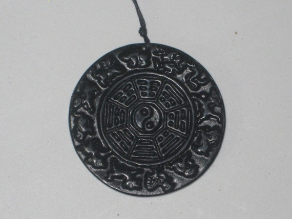 Hand carved black and green jade ying yang and zodiac pendant, with adjustable necklace.