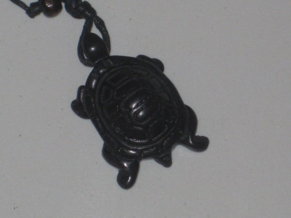 """Surfers black turtle necklace, adjustable up to 32"""" long."""