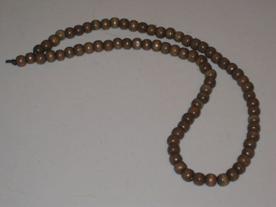 Dark brown wood bead surfer necklace, hand made.