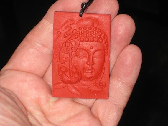 Organic Cinnabar buddha pendant, with adjustable necklace.