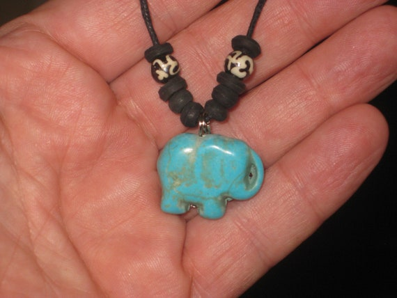 Turquois elephant surfer pendant, with adjustable necklace.