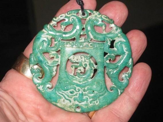 All natural hand carved two sided Jade dragon pendant, with adjustable necklace.
