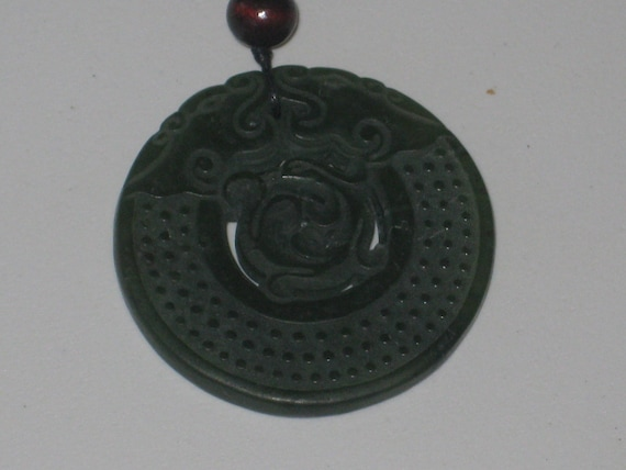 All natural hand carved two sided very old Jade dragon pendant, with adjustable necklace.