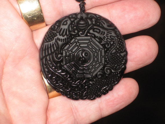 Black Obsidian dragon and phoenix ying yang pendant, with glass bead necklace.