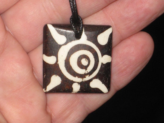 Buffalo bone African tribal sun, hand carved pendant.
