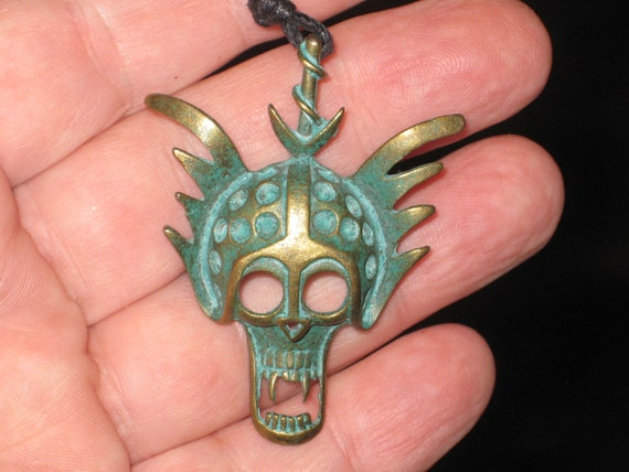 Iodized brass skull warrior mask, with adjustable necklace.