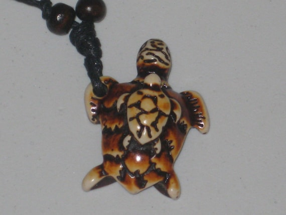 """Surfers sea turtle with baby necklace, adjustable up to 32"""" long."""