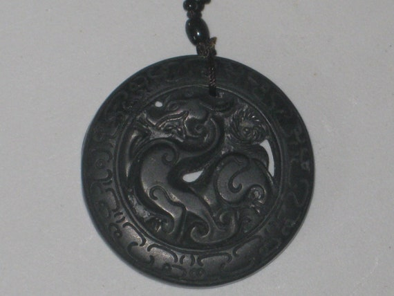 All natural hand carved two sided very old black Jade stone dragon pendant.