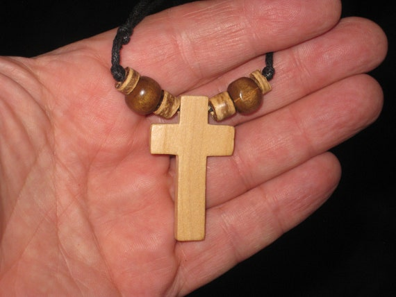 Hand carved wood cross pendant, with adjustable necklace.