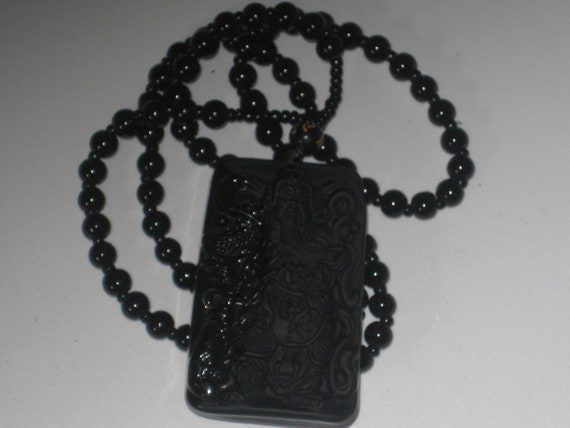 Hand carved black Obsidian Guan Yu pendant, with glass bead necklace.