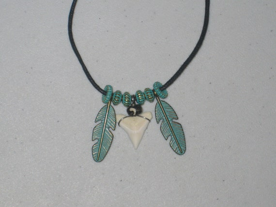 Real shark tooth and feather pendant, with adjustable necklace.