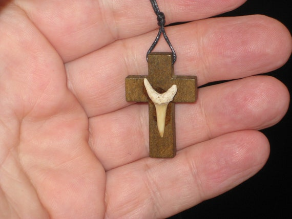 Hand carved wood cross with fossil shark tooth from Morocco, with adjustable necklace.