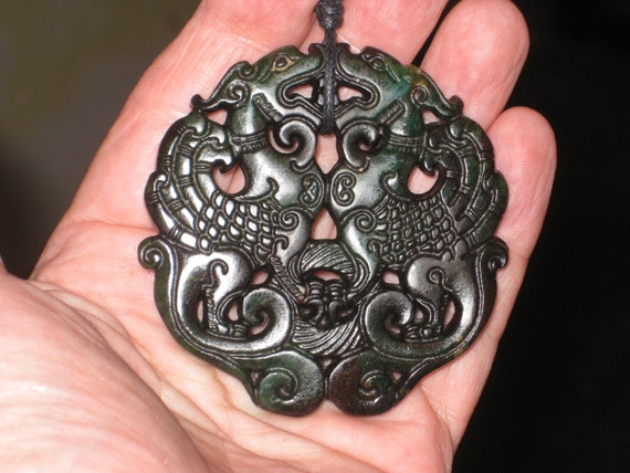 All natural dark black green jade hand carved two sided dragon pendant.