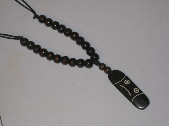 Buffalo bone pendant and wood beads, with adjustable necklace.