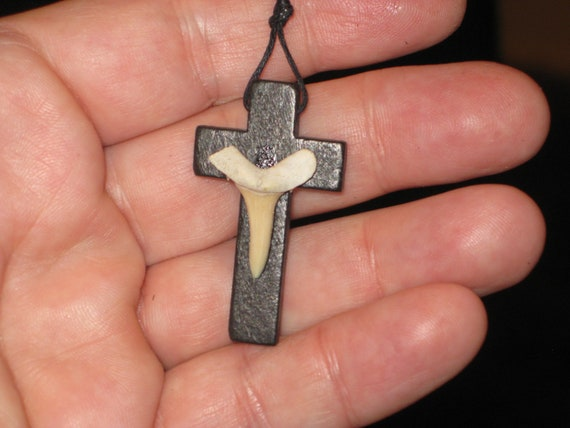 Hand carved wood cross and fossil shark tooth from Morocco, with adjustable necklace.