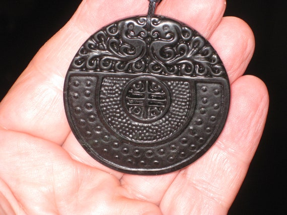 All natural hand carved very old black Jade dragon pendant.