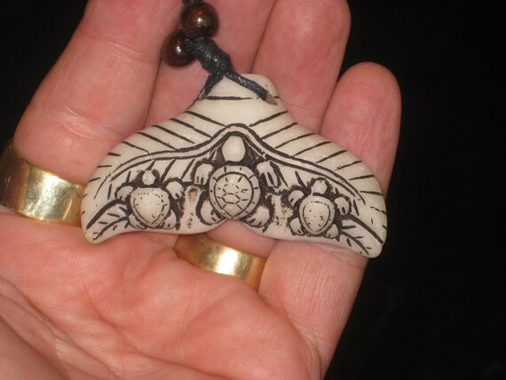 """Surfers whale tail with baby turtles necklace, adjustable up to 32"""" long."""