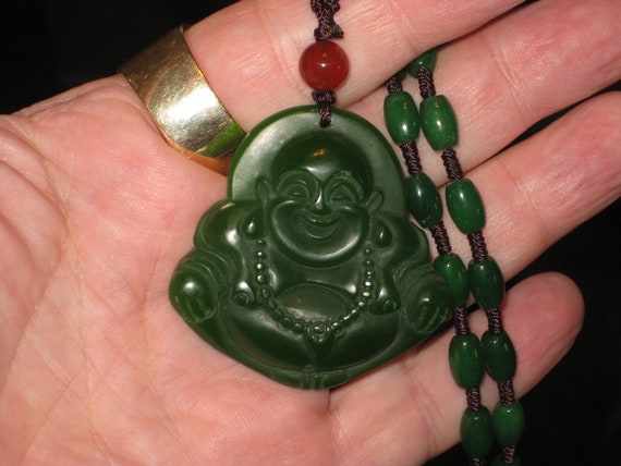 "All natural hand carved Jade Buddha pendant, with jade beads 22"" long."